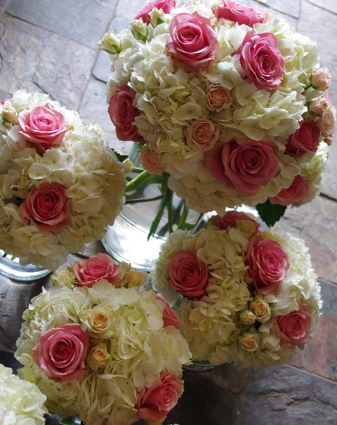 Mass of white Hydrangeas and pink and salmon roses styled in vase - Botany Floral Studio | Toronto Florist