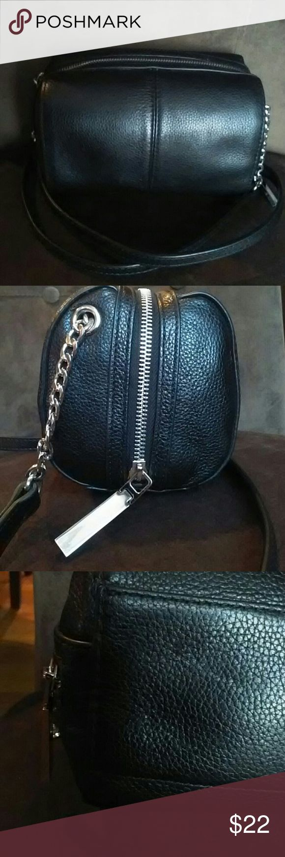 """Neiman Marcus Black Cross Body/Shoulder Purse This chic Neiman Marcus purse is small, yet roomy.  One interior zippered pocket, and an interior ID/credit card slot.  Measures approximately 7x4.5x4.5.  Drop is approximately 21.5"""".  Some light tarnishing to zipper tab, and a light scratch to the leather on bottom of the purse.  Gently used, and in very good condition. Neiman Marcus Bags Crossbody Bags"""