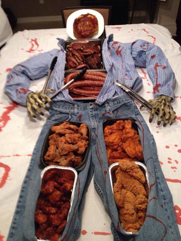 The Walking Dead/Halloween buffet table: Meatloaf head, ribs, sausage, and assorted chicken wings.