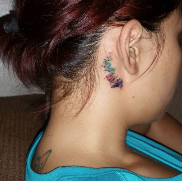 Behind-The-Ear Book Tattoo by Arcee - I think I've wound up wanting something that curls up this way.