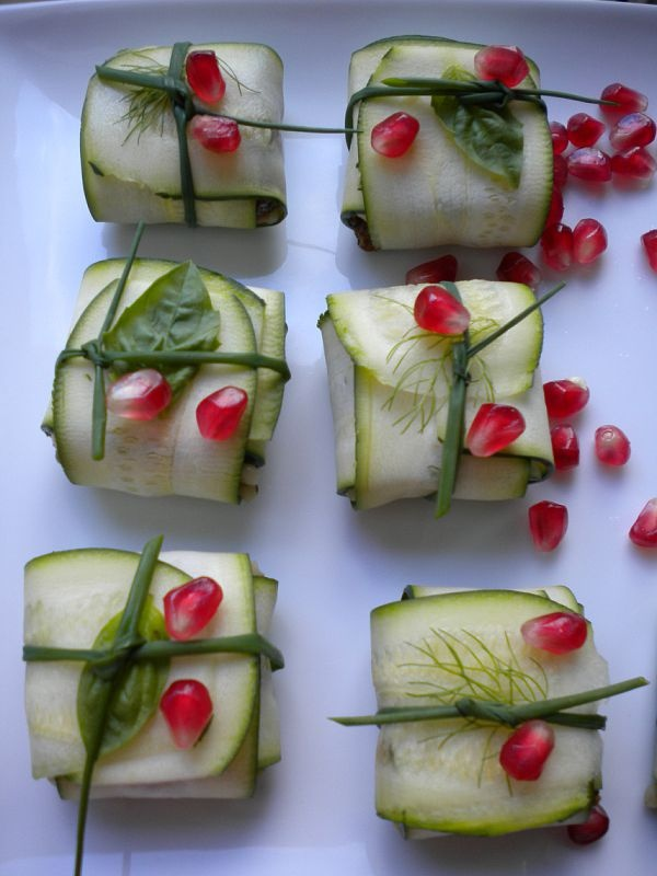 Mediterranean Baskets - thinly sliced raw zuchini wrapped around hummus, tied with chive, sprinkled with pommegranite seeds.