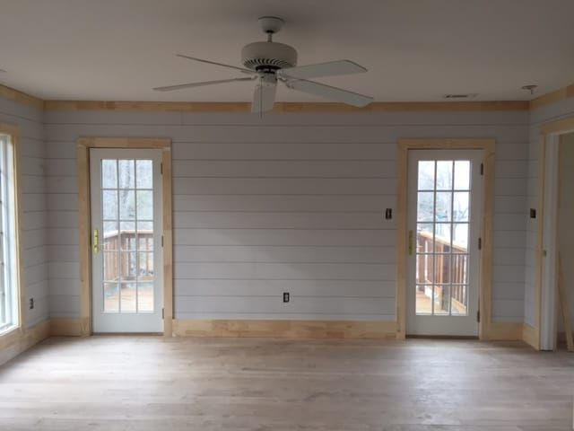 Love the wood trim with white shiplap.
