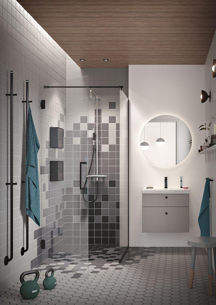 Följ den svarta tråden i badrummet och kombinera med en effektfull belysning bakom spegeln och härliga inslag med trä.
