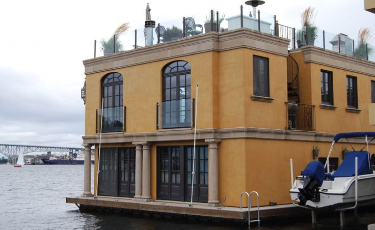 Tuscan style houseboat is a permanent residence