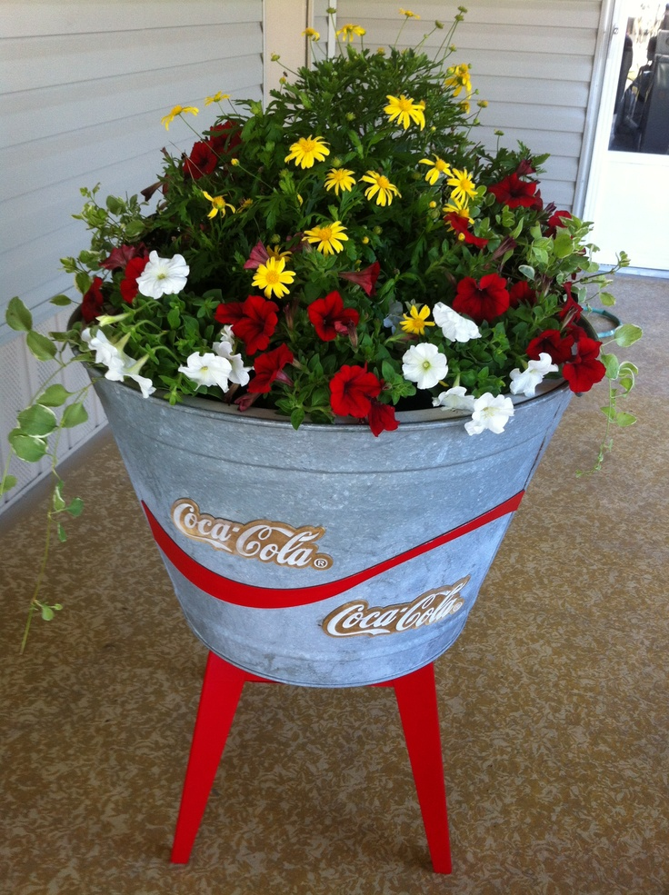 Yard sale find for DIY! A vintage Coca Cola tub and stand; add a little paint and flowers for a unique container garden.