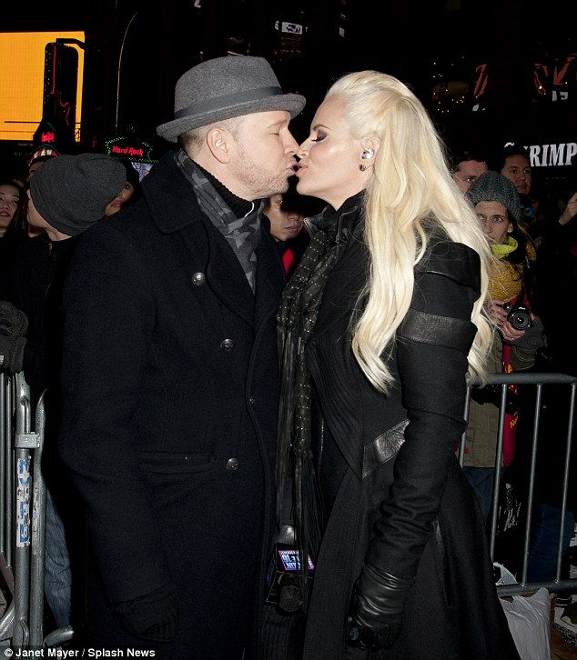 Pucker up! Jenny McCarthy and husband Donnie Wahlberg proved their just as loved-up as eve...