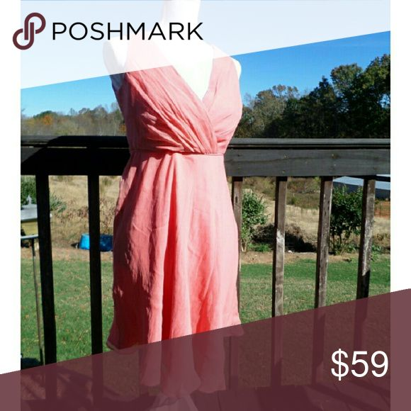 J.Crew Salmon Flowy Silk Bridesmaid Dress J.Crew Salmon Flowy Silk Bridesmaid Dress. Simple, yet adorable & classy. NEW WITH TAGS. Size 4P. Paid $129.99 on sale online for a wedding but never ended up wearing it. J. Crew Dresses Wedding