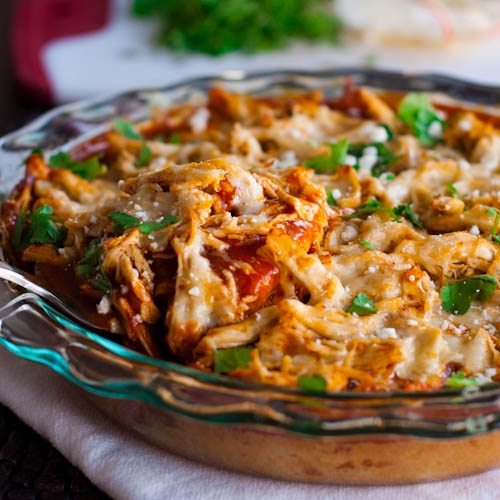 Chicken Tamale Pie.with creamed corn, Jiffy corn muffin mix, milk, can of green chilies, red enchilada sauce, red pepper & cheeses