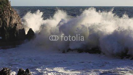 Manarola cliff with big waves