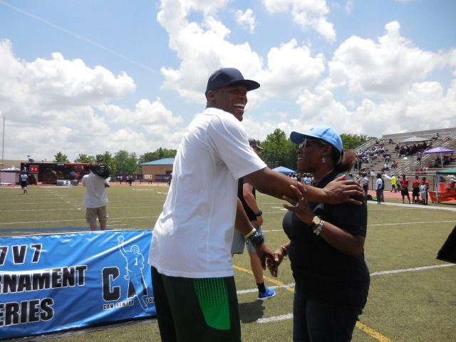 Cam Newton and his mom Jackie Newton kid around on the field of his alma mater, Westlake High School. Photo: Jennifer Brett