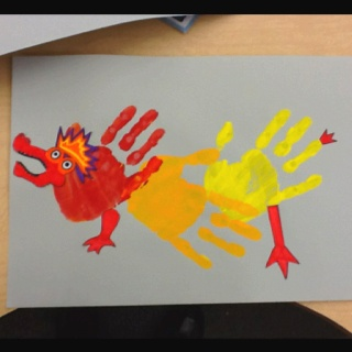 Painted Handprint Chinese New Year Dragon - there is no link with instructions and the photo was uploaded by user but it would be easy to recreate with paint and paper.