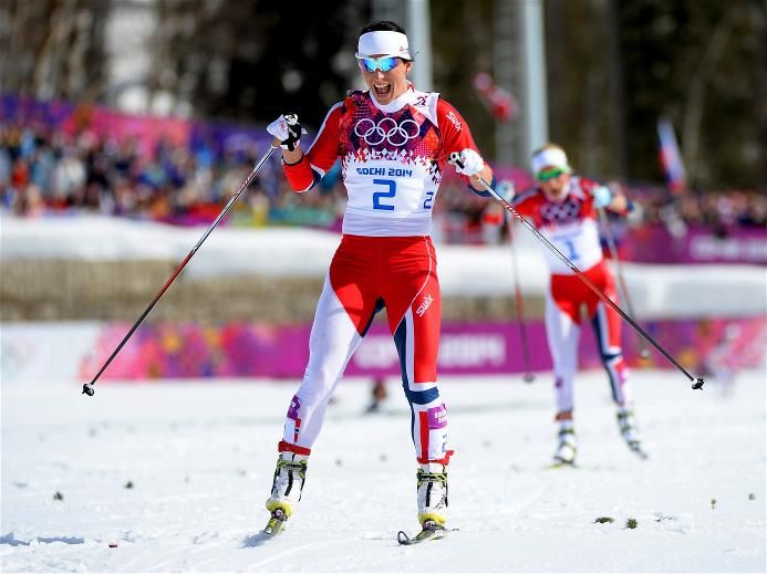 Marit Bjoergen of Norway wins the Women's 30 km Mass Start Free