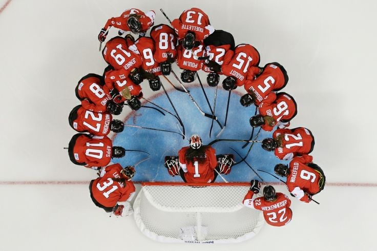 Photos: Canada at Sochi Games - Day 3 |  CTV News at Sochi 2014  ~~ Women's Team Canada Hockey huddles around goalkeeper Shannon Szabados before their game against Findland Monday Feb, 10, 2014.