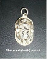 Sterling Silver Scarab Beetle Pendant The scarab beetle represented ascension, renewal and rebirth in ancient Egypt. The back side of the pendant has the same cartouche inscription as that for King Tut.   FOR MORE DETAILS AND TO BUY VISIT:  http://www.sanctuaryofwellness.ca/egyptian-style-jewelrygifts.html --Edmonton, Alberta.