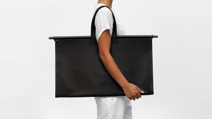 Startup fashion brand The Atelier YUL has designed a range of minimal cases for architects transporting their papers and models.