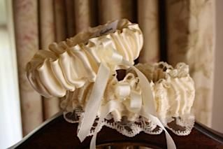 Main garter:  Beige satin with lace. Tossing garter:  Beige satin with bow. louise@heavenlygarters.co.za