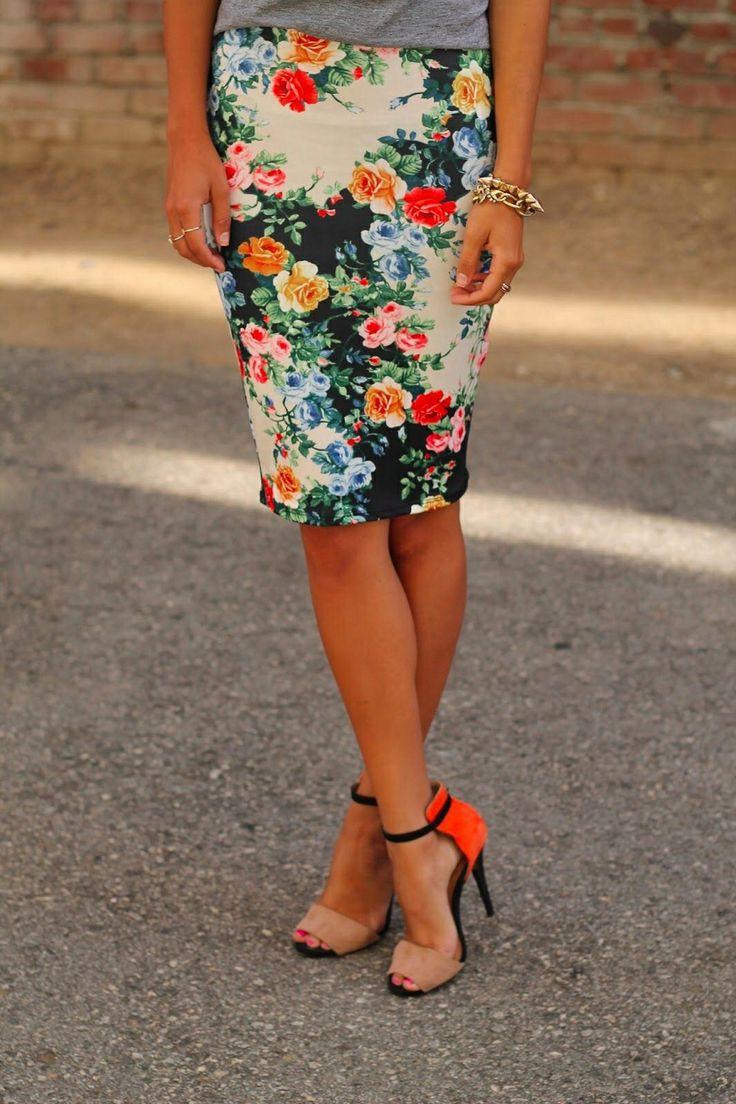 JW fashion, modest. Floral skirt, bright heels