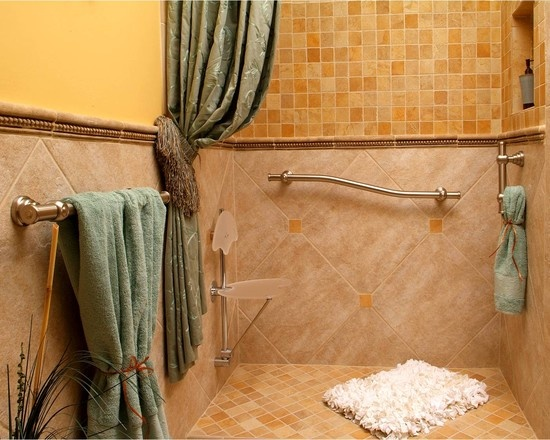 """a curbless shower that showcases Great Grab grab bars and decorative tile work""""  """"Curbless shower, decorative seat and grab bars""""  """"curbless - nice drape of shower curtain - nice inconspicuous chair in shower"""""""