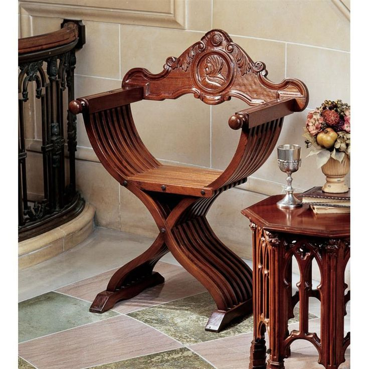 """Our classic 15th-century scissor chair was named after the charismatic Dominican monk Girolamo Savonarola. Once, only the most wealthy could afford an exquisite, hand-carved chair with the scissor-like principle that allowed it to be folded and easily moved. Our exclusive historical replica is true to the original design, with 16 ribbed, serpentine, cross-strut legs, hand-cut from solid teak, and a bas-relief profile of Savonarola carved into the backrest.21""""Wx21""""Dx37""""H. 30 lbs..."""