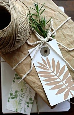 brown paper and string, leafy tag and a sprig of rosemary. lovely.