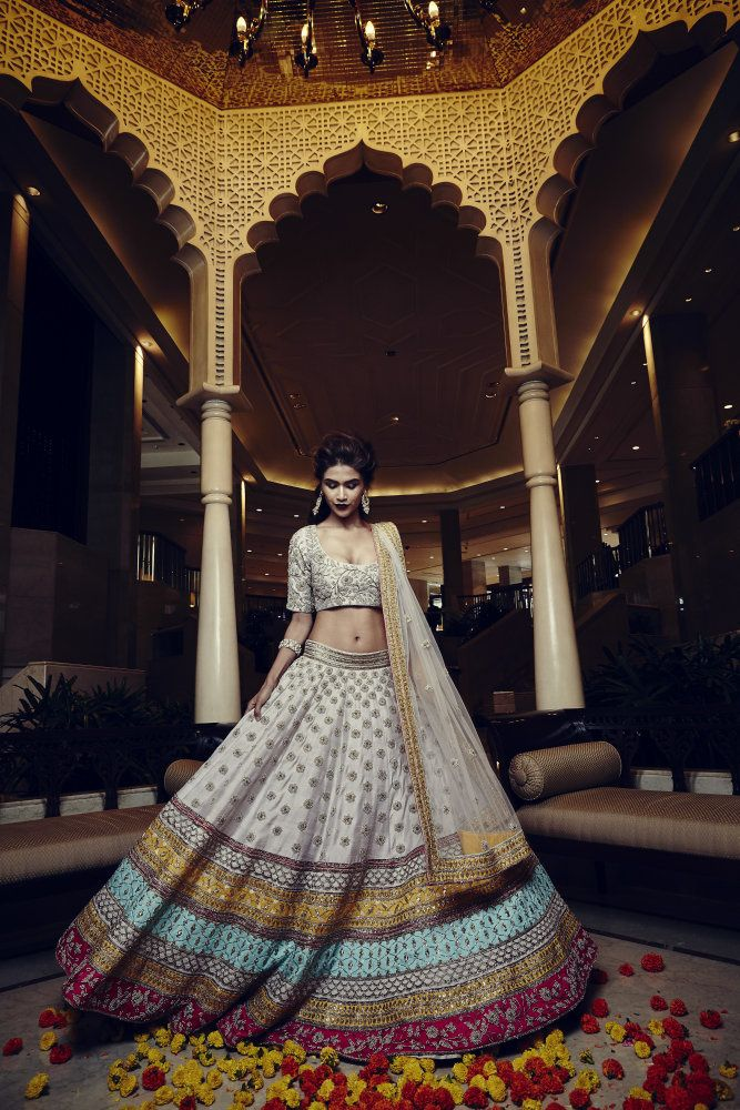 Sangeet Lehengas - Beautiful White Lehenga with a Broad Pink, Yellow, Sky Blue and Copper Border and a White Net Dupatta, Embroidery on Blouse | WedMeGood | Trending on the Website: www.wedmegood.com Outifit By: Payal Singhal #wedmegood #bridal #lehengas #indianbride #indianwedding #white #choli