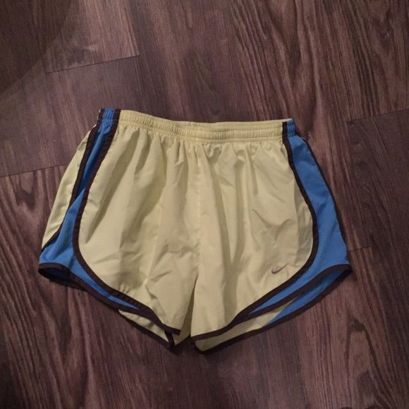Women's Nike shorts Yellow shorts with blue and gray stripe. Women's small. Lining inside. Like new. Nike Shorts
