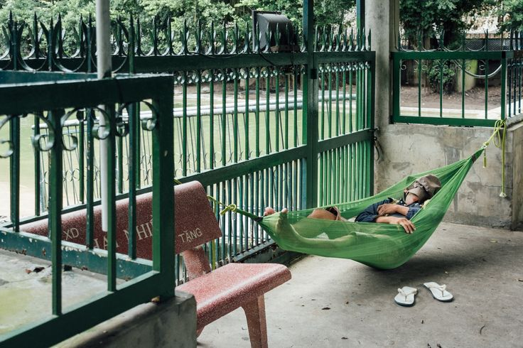Napping - Worker at a corodile farm/park napping during lunch break.