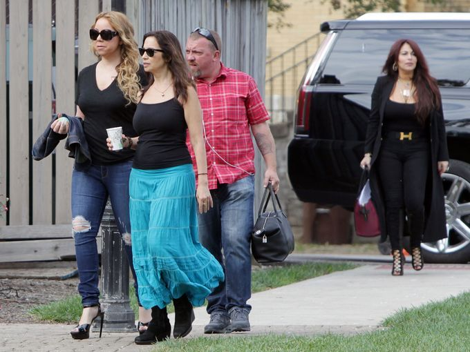 Mariah Carey movie transforms Wyoming. Photo: Mariah Carey (left), who is directing a Christmas-themed film in Wyoming, arrives on the set at the Village Green. The Enquirer/Patrick Reddy