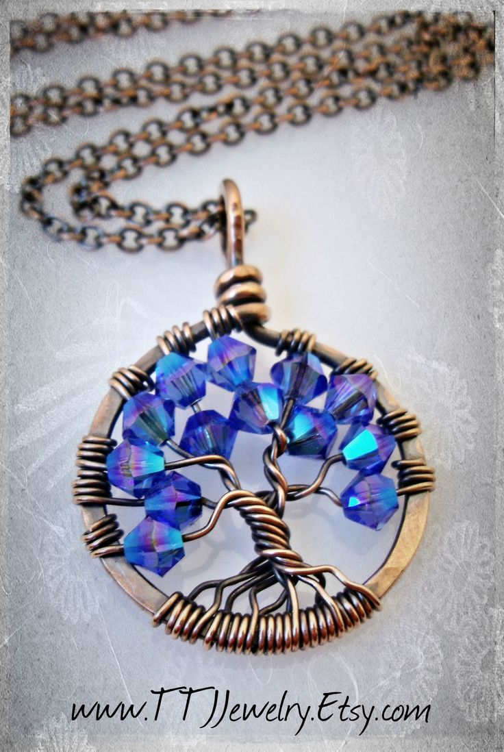 Wire wrapped antiqued copper mini crystal tree of life necklace. Only about the size of a penny! Gorgeous and super sparkly sapphire blue Swarovski crystals. Wire wrapped jewelry is the perfect unique gift. Many other colors available! https://www.etsy.com/listing/198604698/labor-day-sale-tree-of-life-necklace?ref=shop_home_active_20