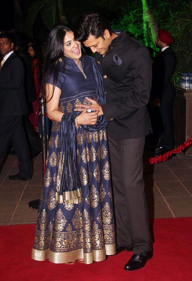 Picture perfect! Riteish Deshmukh with pregnant Genelia D'Souza Deshmukh at Arpita Khan's wedding reception in Mumbai. #Bollywood #Fashion #Style #Beauty