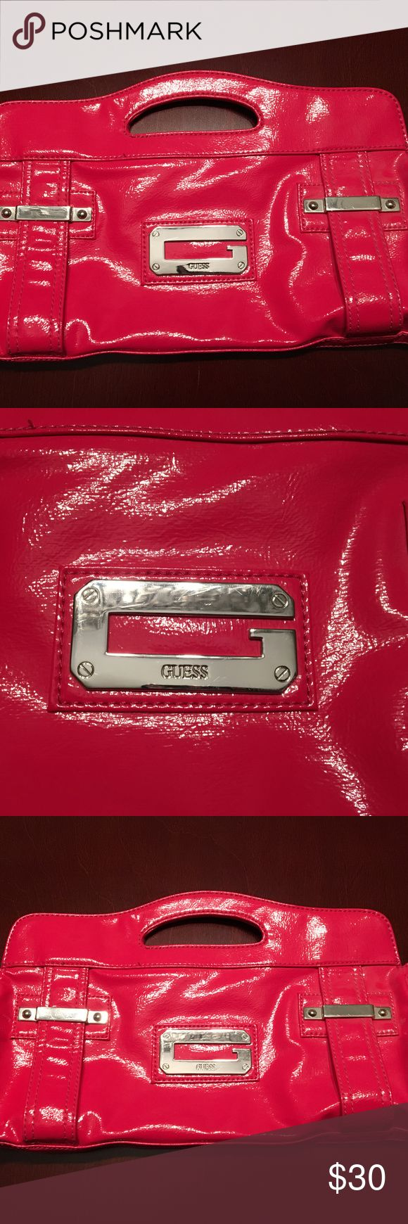 Large Guess Clutch This clutch holds everything! Makes for the perfect night out bag. There are magnetic snaps but there is an inside zippered pocket. Inside and out this bag is beautiful! Guess Bags Clutches & Wristlets