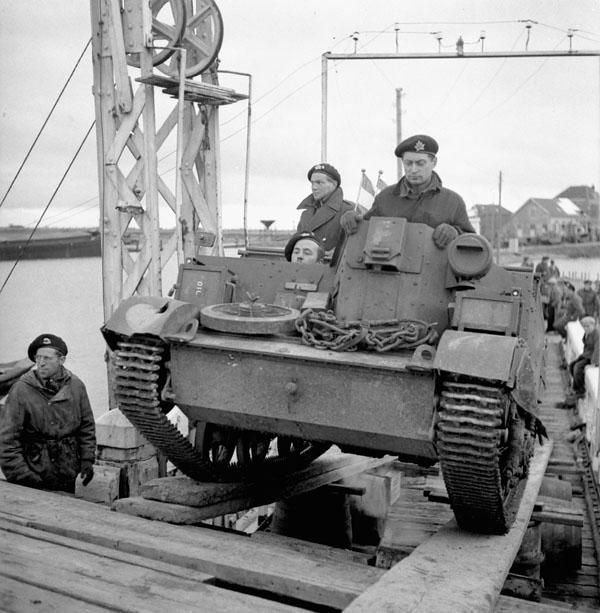 A Universal Carrier of the 14th Canadian Hussars being loaded aboard a barge en route from South Beveland to North Beveland, Netherlands, November 1st 1944.