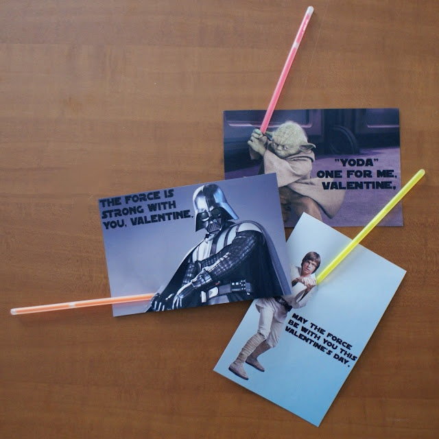 """Pinner said, """"YES! Glow bracelets tucked into printable cards (doc available at link) makes a trio of fantastic Star Wars Valentines for kids, nerds and nerdy kids alike. I love them so much, I won't gripe about light saber color accuracy (and in doing so give away how firmly I fit into the """"nerd"""" category)."""" - Zander would love this!"""