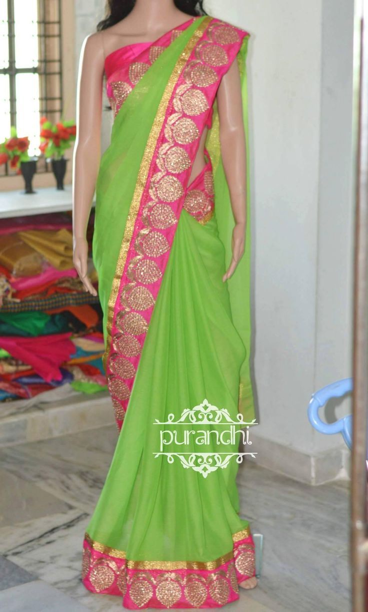 BACK IN STOCK!!!We cannot take more than 2 ordersparrot green pure chiffon saree finished with pink raw silk wire worked border and gold jari border and it comes with pink raw silk blouse fabic and border for hands to make the pattern Price : 3400/-