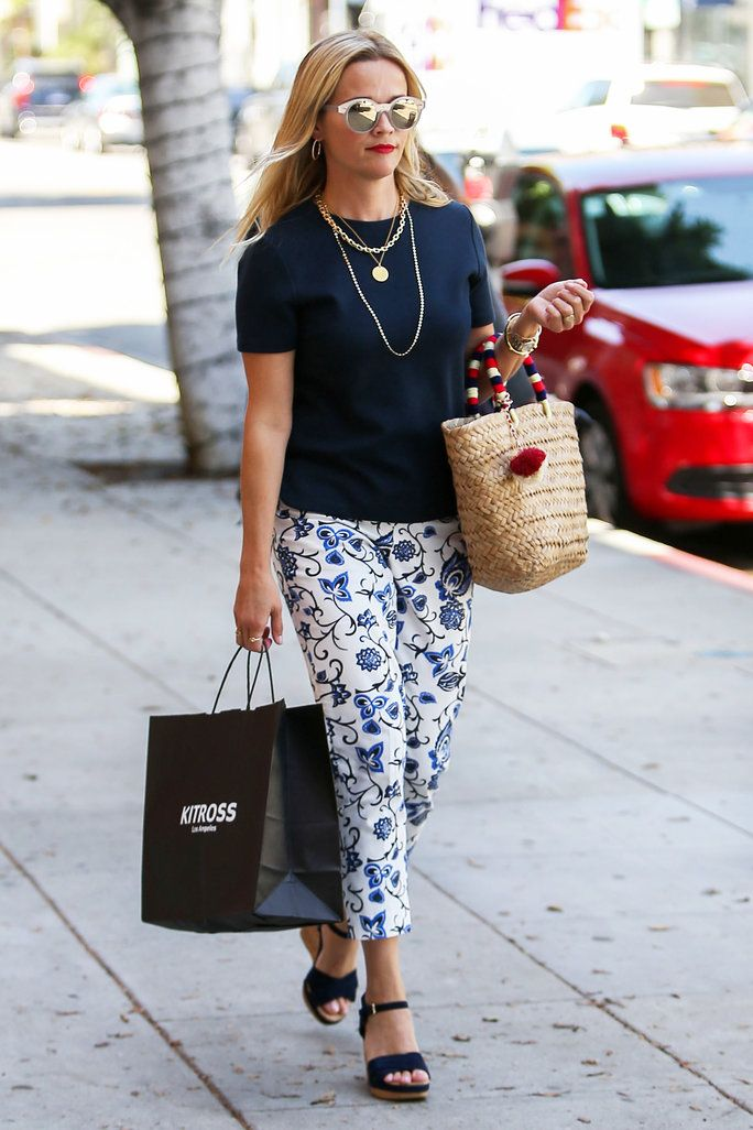 ab63a5440 Reese Witherspoon Makes Us Want to Wear Floral Pants All Summer | Reese  Witherspoon hit the streets of L.A. on Monday in an outfit that showcased  her ...