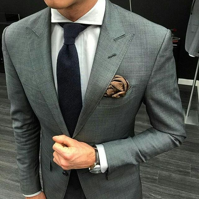 Good morning. The sharp angles in the lapels and cutaway collar rule this outfit.