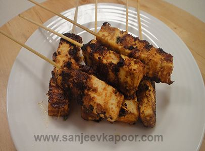 Cottage cheese marinated in Thai red curry paste and grilled.