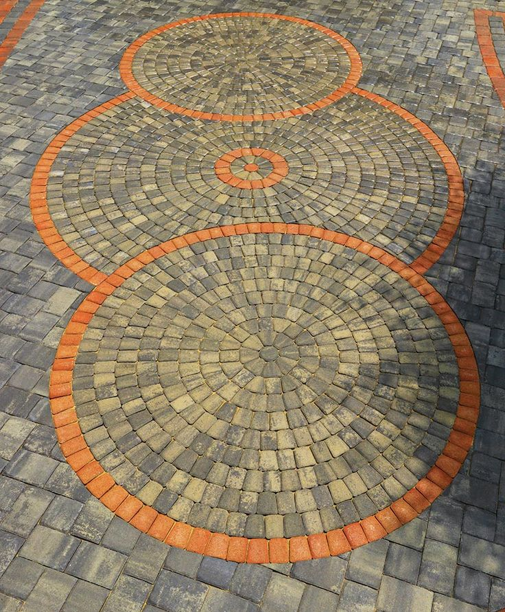 multi colored pavers in a spiral pattern accented with