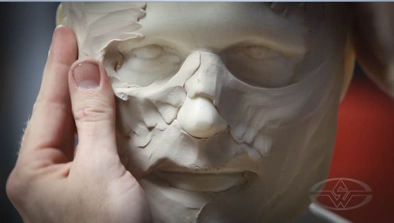 A head form (available commercially from monstermakers.com) serves as the base for the mask which Bruce builds up with a clay layer.