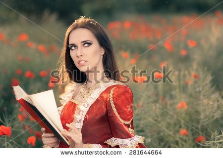 Princess Reading a Book in Summer Floral Landscape - Portrait of a happy beautiful queen in red royal dress in a flower field