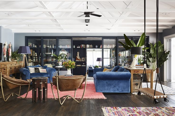 The pink rug in the living room is from Marr-Kett, a new and vintage housewares shop in Byron Bay, Australia.
