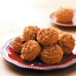 """Pumpkin Oat Bran Muffins Recipe -""""The aroma from these muffins is especially wonderful in the fall. They're healthy and yummy and disappear quite quickly. They also freeze well."""" Irene Robinson - Cincinnati, Ohio"""