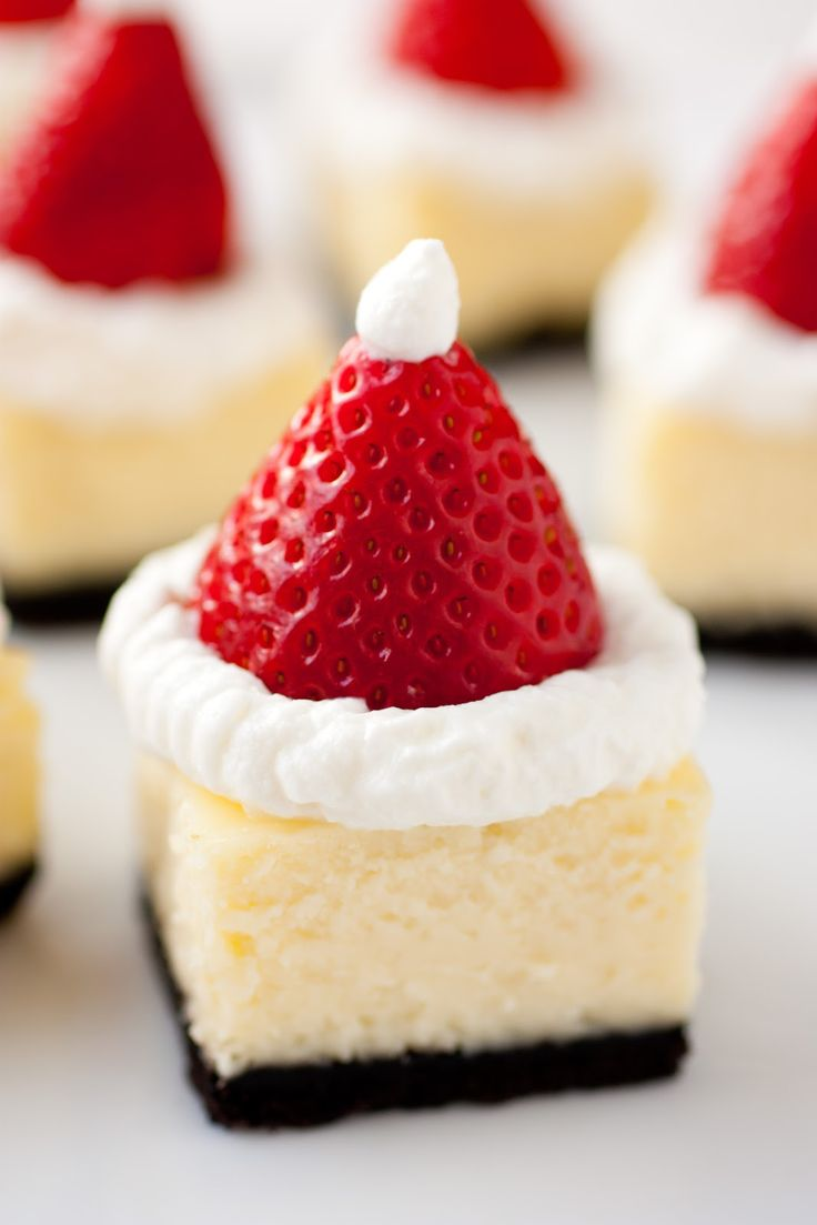 Santa Hat Cheesecake Bites - white chocolate cheesecake, oreo crust, whipped cream and strawberry. Can be made with store bought cheesecake.