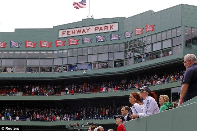 Moving: Boston Baseball fans watch a video montage showing the events of the past week before the game