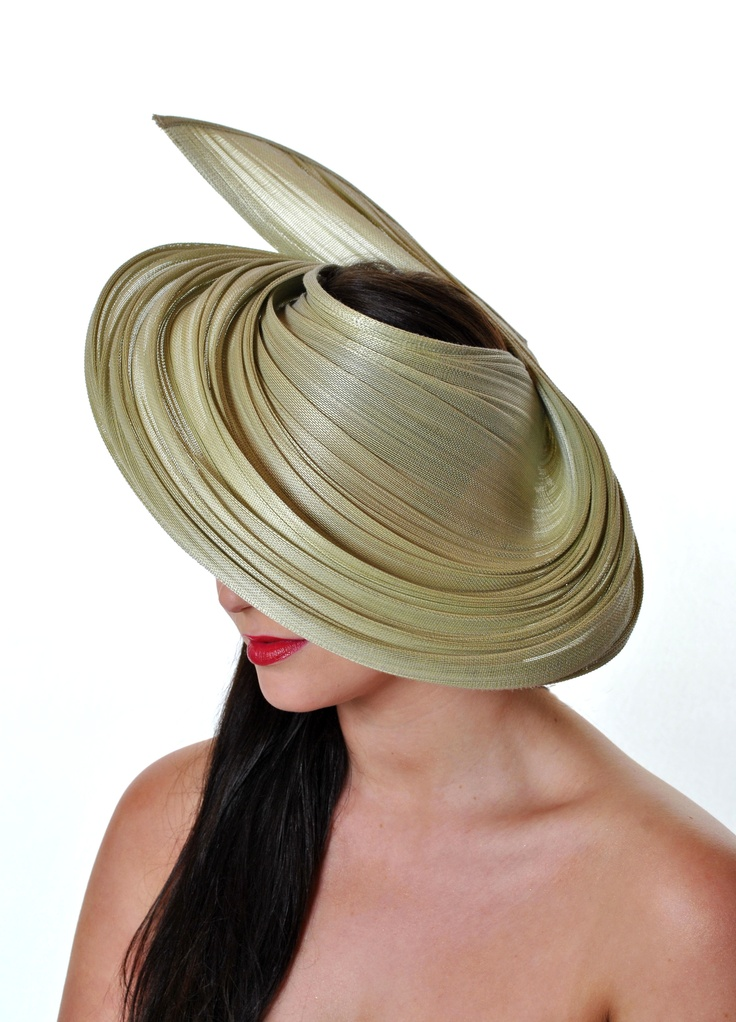 Janis by Laura Jayson at Jayson Kinsella Millinery. Looks like the silk straw I got to use in my recent class.