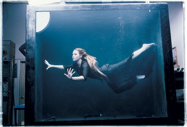 Annie Leibovitz :: Kate Winslet in a water tank—re-envisioning her role as Rose DeWitt Bukater in *Titanic*—but the photographer decided to keep the frame wide enough to reveal the brilliant artifice behind it all. (1998)