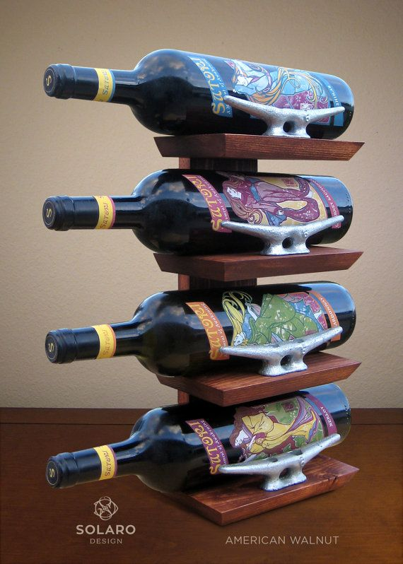 Nautical-themed standing wine rack with 6 galvanized dock cleats to secure the bottles in place. Best for wine you wish to preserve while displaying the labels. - Keyhole fasteners on the back for option to hang on a wall. - Stained in your choice of Summer Oak, American Walnut, Dark Walnut, Kona, Weathered Gray and Cape Cod Gray. - Coated with satin polyurethane for a soft sheen. - 8.5W x 16H x 5D  *Bottles not included.