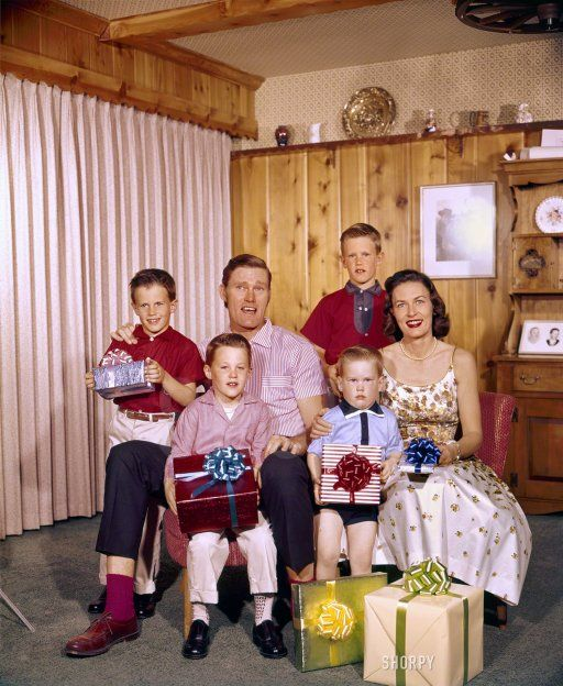 Merry Christmas from the family. Actor Chuck Connors, his wife Betty and their sons Jeffrey,...