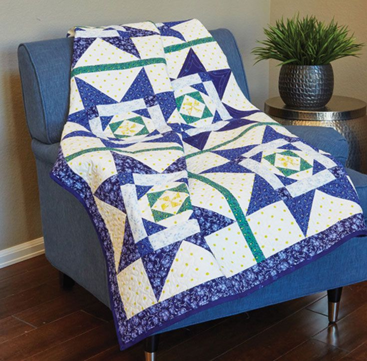 Oversized blue stars shine in this cozy throw quilt. These easy-to-piece blocks go together in a jiffy!