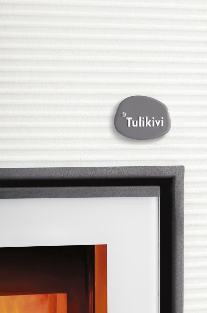 Tulikivi Hiisi soapstone fireplace here with white coating.